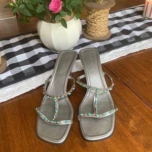 Bandolino  8 1/2 silver heels with torques straps!